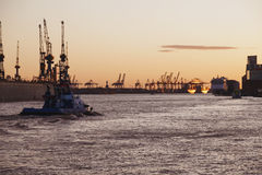 Tugboat at sunset in the Port of Hamburg Stock Photo