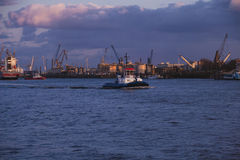 Tugboat at sunset in the Port of Hamburg Royalty Free Stock Image