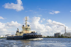 Tugboat Svitzer Muiden has finished his job. Royalty Free Stock Images