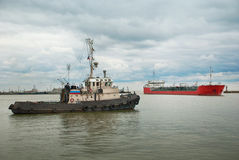 Tugboat and tanker. Royalty Free Stock Image