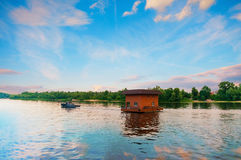 Tugboat towing house by river, Dnieper, Kiev, Ukraine Royalty Free Stock Photos