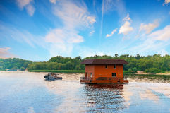 Tugboat towing house by river, Dnieper, Kiev, Ukraine Stock Photo