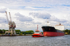 Tugboat towing a ship Royalty Free Stock Photo