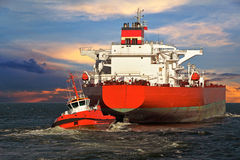 Tugboat towing a ship Stock Photography