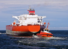 Tugboat towing tanker Stock Image