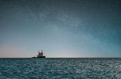 Tugboat under the Milky Way. Picture of a tugboat under the milky way. Picture taken from Mølen in Larvik, Norway Royalty Free Stock Image