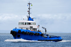 Tugboat Underway C1. Tugboat Underway in calm sea Royalty Free Stock Image