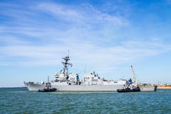 Tugboats  helping destroyer USS Jason Dunham in Helsinki Royalty Free Stock Images