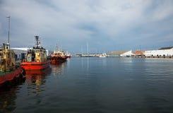 Tugboats moored in port, nobody inside. Tugboats moored in port,  nobody inside Royalty Free Stock Image