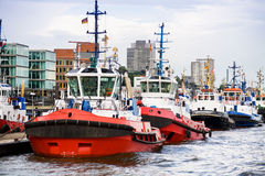 Tugboats in a row. Tugboats waiting in a row at pier Stock Image