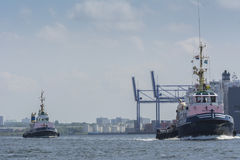 Tugboats sailing in the port of Amsterdam. Royalty Free Stock Photography