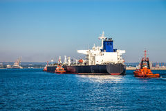 Tugboats and tanker Royalty Free Stock Photo