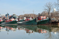 Tugboats. Tugs move vessels that either should not move themselves, here are several in a row Royalty Free Stock Photography