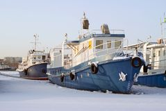 Tugboats during wintering in the backwaters royalty free stock photo