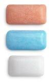 Tugga eller bubbelgummar på vit arkivbild