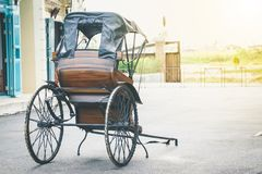 Tugging-cart old antique two-wheel used to receive - send people.  royalty free stock photo