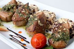 Tuggor av griskött med ris Royaltyfria Bilder