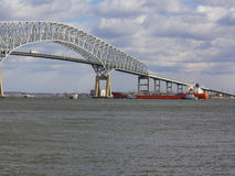 Tugs assisting tanker near Baltimore`s Key Bridge royalty free stock image
