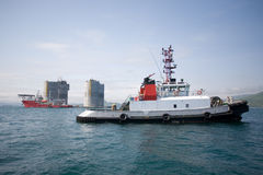 Tugs at the base offshore oil platform Stock Photo