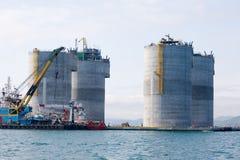 Tugs at the base oil drilling platform. Ocean tugs at the base of offshore oil drilling platform. Sea Japan. Russian coast Royalty Free Stock Photography