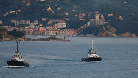 Tugs at La Spezia. A pair of tugs heading for the next job in La Spezia harbour, Italy Royalty Free Stock Photos
