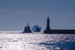 TUGS AND SHIP Stock Images