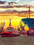 Tugs with ship Royalty Free Stock Photos