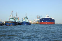 Tugs and tanker Stock Photo
