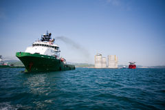 Tugs towing base oil platform Royalty Free Stock Image