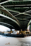 Tugs under the green bridge Stock Photography