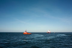 Tugs and vessel. Royalty Free Stock Photo