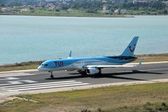 TUI Airways aircraft. Taxiing for take off at the Corfu International Airport, Greece. TUI Airways is the world`s largest charter airline, offering scheduled royalty free stock images