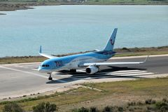 TUI Airways aircraft. Taxiing for take off at the Corfu International Airport, Greece. TUI Airways is the world`s largest charter airline, offering scheduled stock photos