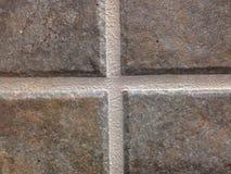Tuile de marbre, plan rapproché, avec le coulis Image libre de droits