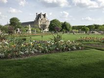 The Tuileries Garden in the center of Paris with Musée du Louvre on the background. The Tuileries Garden French: Jardin des Tuileries is a public garden royalty free stock photography