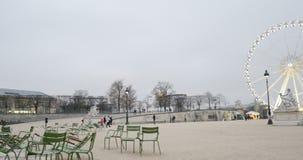 Tuileries Garden, Grand Roue and Obelisk Luxor Paris France. PARIS, FRANCE - CIRCA 2015: Basin Octogonal in Tuileries Garden and Paris green chairs with panning stock footage