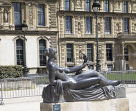 Tuileries garden. Parisians and tourists in famous Tuileries garden. Tuileries Garden Jardin des Tuileries is a public garden located between the Louvre Museum Royalty Free Stock Photo