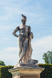 Tuileries garden statue. Tuileries Garden (Jardin des Tuileries) is a public garden located near Louvre Museum. Stock Image