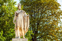 Tuileries garden statue. Tuileries Garden (Jardin des Tuileries) is a public garden located near Louvre Museum. Stock Photo
