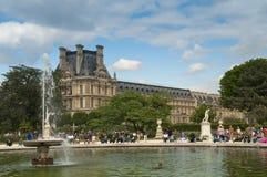 Tuileries garden. Tourists sit next to Tuileries garden's fountain, Paris France Stock Photos