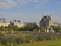 Tuileries gardens in autumn. View on the Paris Tuileries gardens in autumn, with on the right the north wing of the Louvre museum. One of the Paris hotspots Royalty Free Stock Photo