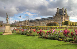 Tuileries gardens in Paris , Louvre museum. Royal gardens and cloudscape Stock Photography