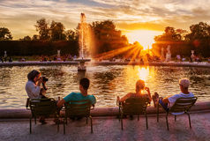 Tuileries Gardens. In Paris, with people relaxing near a fountain Stock Photo