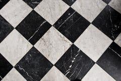 Tuiles de marbre noires et blanches Photos libres de droits