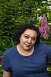 Tuin achter een vrouw stock afbeelding