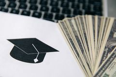 Tuition fee or student loan with calculator. Education price , savings fund college, and expenses concept. Money and royalty free stock photography