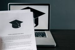 Tuition fee or student loan with calculator. Education price , savings fund college, and expenses concept. Money and. Papers on table. Calculating budget and royalty free stock photography
