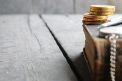 Tuition fees idea, book on wooden table, blurred photo for background Stock Photos