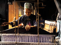 Tujia nationality Old woman weaving Stock Photography