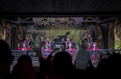 Tujia young boys and girls dancing welcoming stock photo